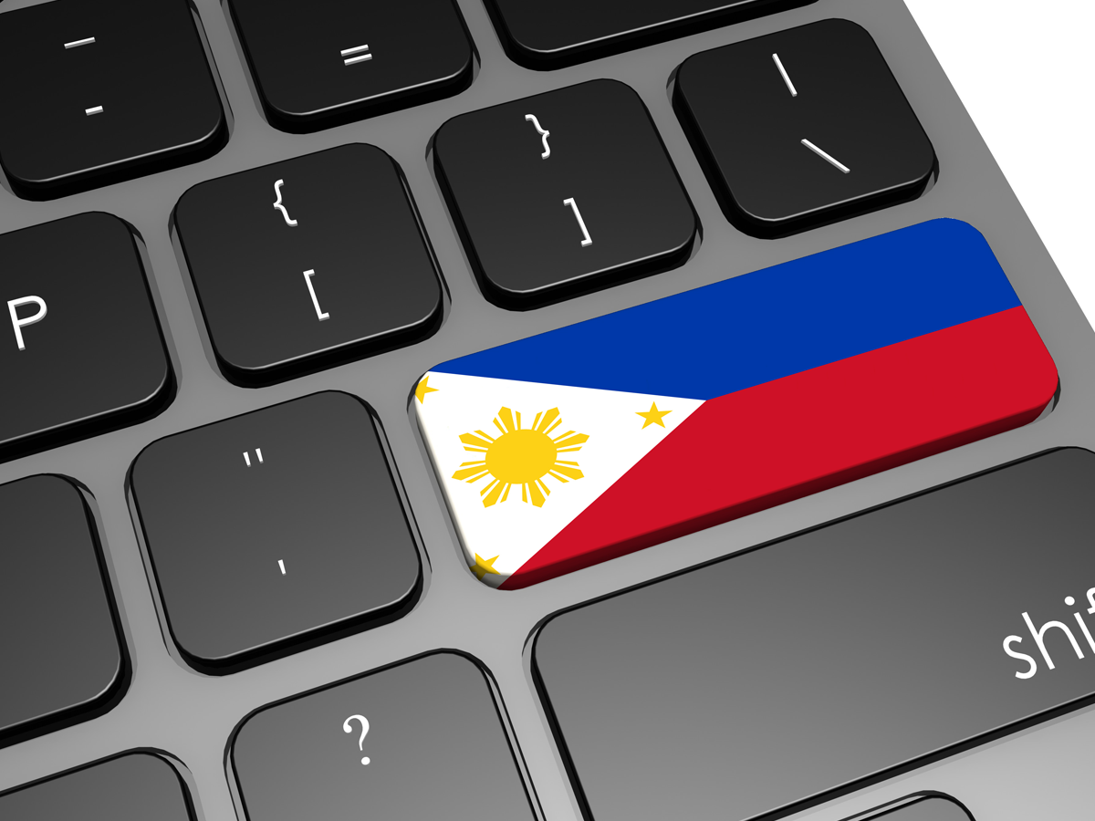 computer keyboard with Philippine flag on key